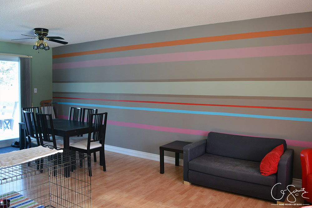 The living and dining room are two combined spaces in our house. Check out pictures of these two areas and the striped accent wall that joins them both together.