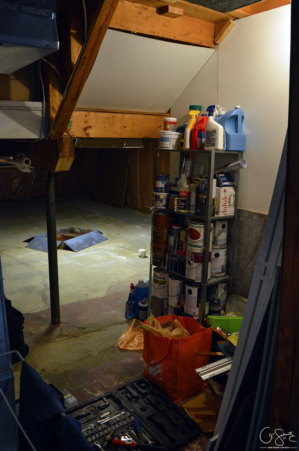 Our unfinished laundry room is dark, dingy, cobweb-y and rough... but every place needs a starting point - at least it's functional :)