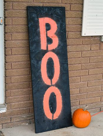 """I made a custom DIY light up board """"Boo"""" sign because I wanted something that would look good in both the daytime and at night. This large marquee-like sign is the perfect addition to our front porch!"""